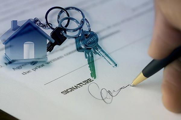 Signature pour la vente d'un logement